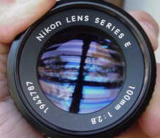 At left a single coated lens Video Camera Lens Reflection